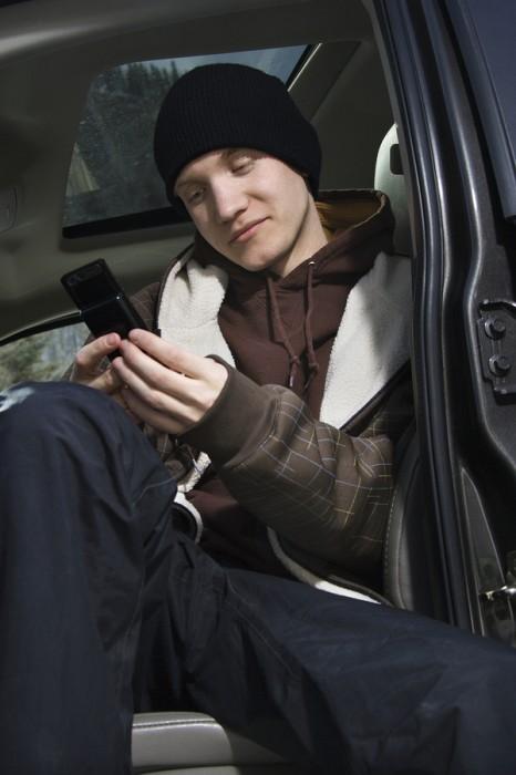 bigstock-Teen-Holding-Cellphone--2682574